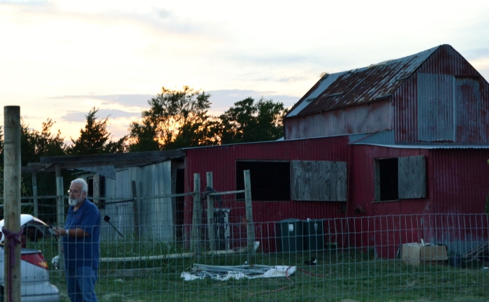 this old barn may not be much for some people, but we sure love it. oh, and that is my husband, Stephen.